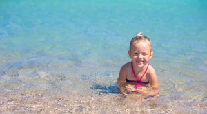 Adorable little girl have fun at tropical beach